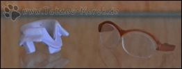Ein zweiter Kragen und die Brille sind ebenfalls dabei